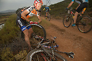 Annika Langvad battles to repair a puncture, causing a massive dent to their lead, during stage 1 of the 2014 Absa Cape Epic Mountain Bike stage race held from Arabella Wines in Robertson, South Africa on the 24 March 2014<br /> <br /> Photo by Greg Beadle/Cape Epic/SPORTZPICS