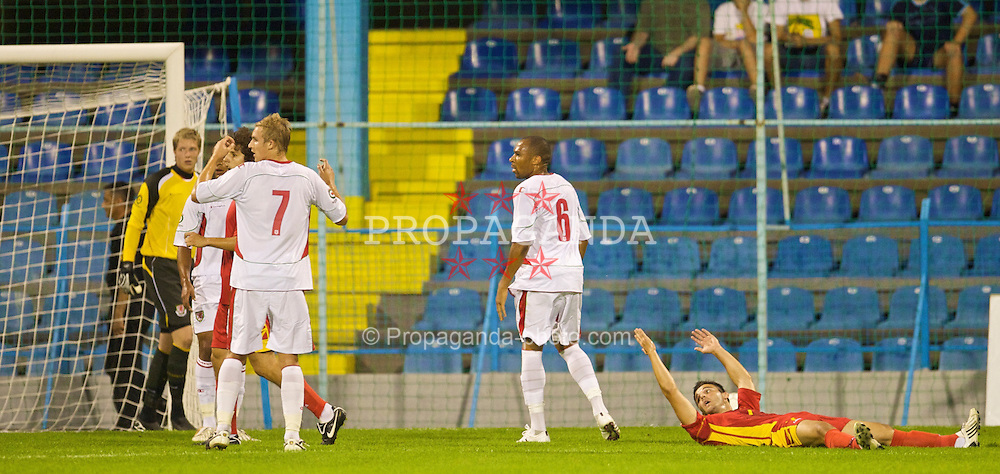 PODGORICA, MONTENEGRO - Wednesday, August 12, 2009: Wales' Daniel Gabbidon looks dejected after Montenegro win a penalty during an international friendly match at the Gradski Stadion. (Photo by David Rawcliffe/Propaganda)