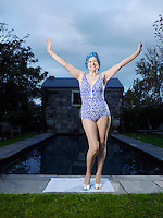 Senior woman posing by pool (portrait)