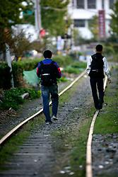 SOUTH KOREA MASAN 29OCT07 - Two Korean teenagers walk on a disused railway line in downtown Masan, south Korea...jre/Photo by Jiri Rezac..© Jiri Rezac 2007..Contact: +44 (0) 7050 110 417.Mobile:  +44 (0) 7801 337 683.Office:  +44 (0) 20 8968 9635..Email:   jiri@jirirezac.com.Web:    www.jirirezac.com..© All images Jiri Rezac 2007 - All rights reserved.