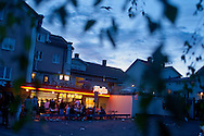People eating fast food at a late night restaurant. Midsummer night, Leksand, Sweden
