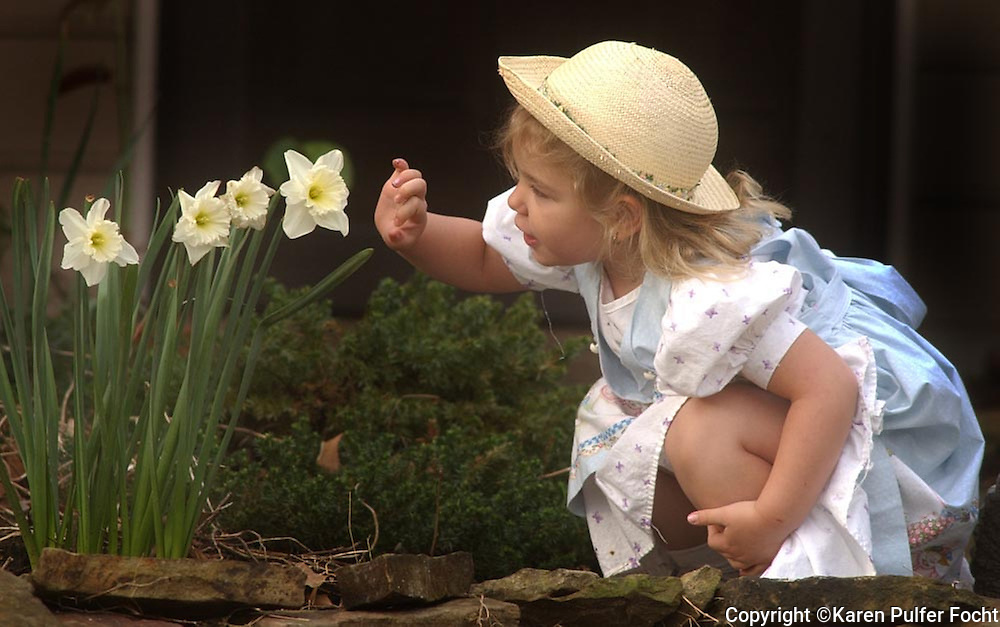 Portrait of a girl with with daffodils.