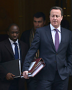 © Licensed to London News Pictures. 13/02/2013. Westminster, UK British Prime Minister David Cameron leaves Downing Street today 13th February 2013 with Sam Gyimah MP and Parliamentary Private Secretary for David Cameron (L). Prime Ministers Questions at The Houses of Parliament. Photo credit : Stephen Simpson/LNP