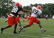 BEREA, OH - AUGUST 3:  Defensive back Leigh Bodden #28 of the Cleveland Browns pushes tight end Paul Irons #89 out of bounds on a pass play during training camp at the Cleveland Browns Training and Administrative Complex on August 3, 2006 in Berea, Ohio. ©Paul Anthony Spinelli *** Local Caption *** Leigh Bodden;Paul Irons