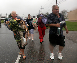 29 August 2012. Braithwaite, Plaquemines Parish, Louisiana,  USA. <br /> Emergency evacuations. Hurricane Isaac batters the community of Braithwaite in Plaquemines Parish where residents were evacuated following the overtopping of a  levee. The water gushed in, inundating peoples houses on the 7th year anniversary of Hurricane Katrina.<br /> Photo;Charlie Varley/varleypix.com