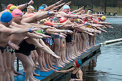 © Licensed to London News Pictures. 25/12/2017. London, UK. Competitors wait to dive in at the start of the race as members of the Serpentine Swimming Club brave the cold waters at the Serpentine Lake in Hyde Park, London to compete for the traditional Peter Pan Cup on Christmas Day, December 25, 2017. Photo credit: Ben Cawthra/LNP