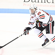 Colton Saucerman #23 of the Northeastern Huskies controls the puck during the game at Matthews Arena on February 22, 2014 in Boston, Massachusetts . (Photo by Elan Kawesch)