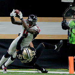 Dec 24, 2017; New Orleans, LA, USA; New Orleans Saints cornerback Marshon Lattimore (23) stops Atlanta Falcons wide receiver Julio Jones (11) short of the goal line during the third quarter at the Mercedes-Benz Superdome. The Saints defeated the Falcons 23-13. Mandatory Credit: Derick E. Hingle-USA TODAY Sports