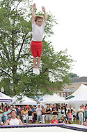 Goshen, NY - A young member of the Skyriders, an acrobatic trampoline team, performs at the Great American Weekend festival on July 5, 2008.