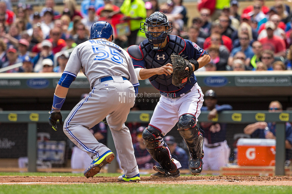 MINNEAPOLIS, MN- MAY 31: Kurt Suzuki #8 of the Minnesota Twins tags out Russell Martin #55 of the Toronto Blue Jays on May 31, 2015 at Target Field in Minneapolis, Minnesota. The Twins defeated the Blue Jays 6-5. (Photo by Brace Hemmelgarn) *** Local Caption *** Kurt Suzuki