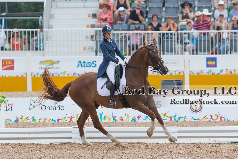 Micaela Mabragana (ARG) and Granada at the OLG Caledon Pan Am Equestrian Park during the Toronto 2015 Pan American Games in Caledon, Ontario, Canada. Granada is the oldest horse competing in dressage.