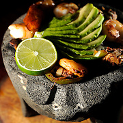 The Molcajete is seen at Senor Tequila Mexican Grill Monday, Aug. 13, 2012 in Tampa. The dish is served on a hot lava rock heaped with sizzling beef strips, chicken, pork and shrimp. Topped with cheese, grilled cactus, peppers, onions, served with rice, beans, lettuce, guacamole, pico de gallo, sour cream and three flour tortillas. CHRIS URSO/STAFF