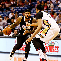 Mar 7, 2016; New Orleans, LA, USA; Sacramento Kings center DeMarcus Cousins (15) drives past New Orleans Pelicans forward Anthony Davis (23) during the first quarter of a game at the Smoothie King Center. Mandatory Credit: Derick E. Hingle-USA TODAY Sports