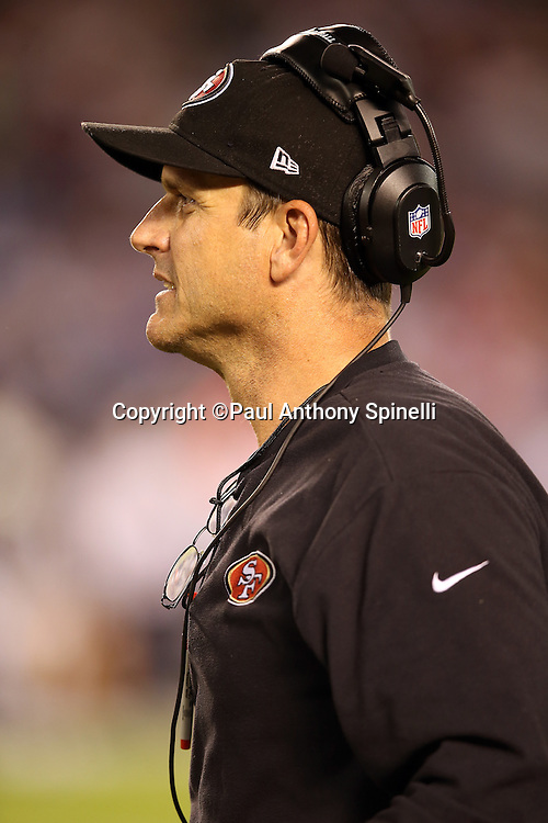 San Francisco 49ers head coach Jim Harbaugh looks on from the sideline during the NFL week 4 preseason football game against the San Diego Chargers on Thursday, Aug. 29, 2013 in San Diego. The 49ers won the game 41-6. ©Paul Anthony Spinelli