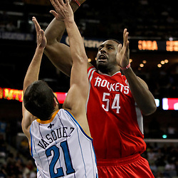 April 19, 2012; New Orleans, LA, USA; Houston Rockets power forward Patrick Patterson (54) shoots over New Orleans Hornets point guard Greivis Vasquez (21) during the second half at the New Orleans Arena. The Hornets defeated the Rockets 105-99.   Mandatory Credit: Derick E. Hingle-US PRESSWIRE
