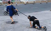 Shocking moment a woman takes her male companion for a walk on a DOG LEASH in China