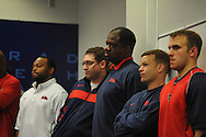 Ole Miss assistant coaches and others listen as Houston Nutt speaks at a news conference Monday Nov. 7, 2011 at the University of Mississippi in Oxford, Miss. Nutt will resign at the end of the season.