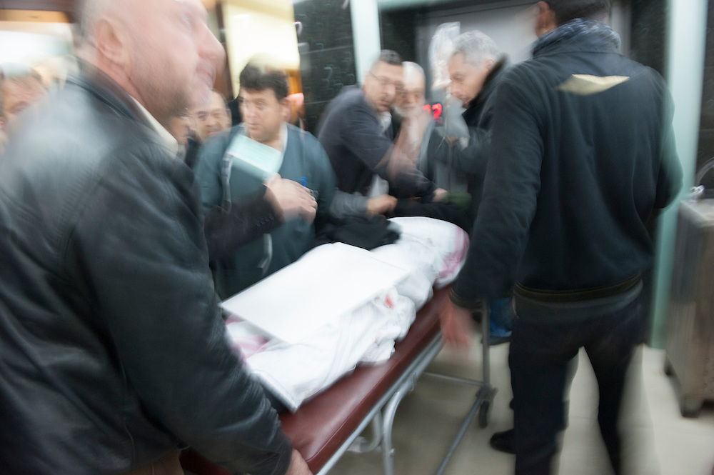 January 11, 2012, Homs, Syria. Wounded are rushed in a hospital near the Hadara district in Homs where mortar boms were fired causing the death of Gilles Jacquier and bystanders in Homs, Syria. It is not proven who performed the attack.<br /> <br /> 11 janvier 2012, Homs, Syrie. Des bless&eacute;s sont pr&eacute;cipit&eacute;s dans un h&ocirc;pital pr&egrave;s du quartier d'Hadara, &agrave; Homs, o&ugrave; l'on a tir&eacute; des mortiers qui ont caus&eacute; la mort de Gilles Jacquier et de passants. Il n'est pas prouv&eacute; qui a effectu&eacute; l'attaque.