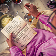 A Pandit (priest), who has selected the day of the wedding based on the bride and groom&rsquo;s horoscopes, reads holy Sanskrit mantras during a Hindu wedding.<br /> Delhi, 2010