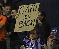 Picture by David Horn/Focus Images Ltd +44 7545 970036<br /> 13/09/2013<br /> A Scunthorpe United fans hold up a banner that says &quot;CAFU IS BACK&quot; to welcome the return of Cliff Byrne during the Sky Bet League 2 match at Roots Hall, Southend.