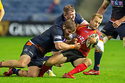 Sarel Pretorius (#21) of Isuzu Southern Kings is tackled by Cameron Fenton (#16) of Edinburgh Rugby (rear) and Pierre Schoeman (#17) of Edinburgh Rugby during the Guinness Pro 14 2018_19 rugby match between Edinburgh Rugby and Isuzu Southern Kings at the BT Murrayfield Stadium, Edinburgh, Scotland on 5 January 2019.