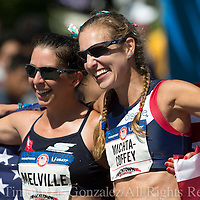Miranda Melville, left, and Maria Michta-Coffey celebrate their top two finishes in the womens Olympic Trials 20K race walk in Salem, Ore., on Thursday  June 30, 2016.