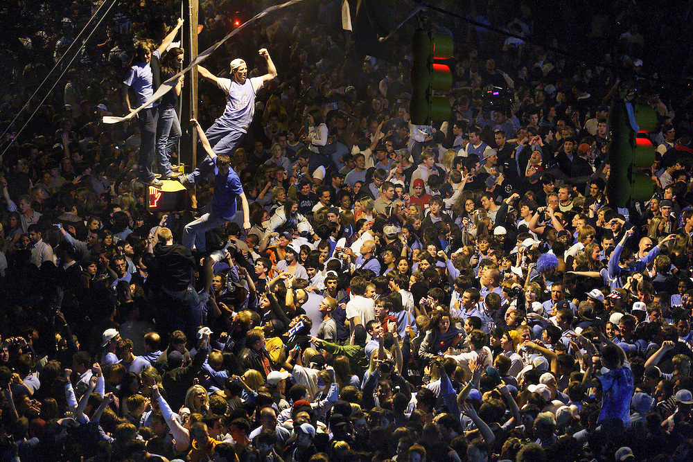 An estimated 30,000 people crammed in a half-mile stretch of Franklin Street on April 6, 2009, to celebrate the University of North Carolina at Chapel Hill's Men's basketball NCAA championship in Chapel Hill, NC. The UNC Tarheels defeated the Michigan State Spartans in the Championship game in Detroit, Michigan. (Photograph by Logan Mock-Bunting)