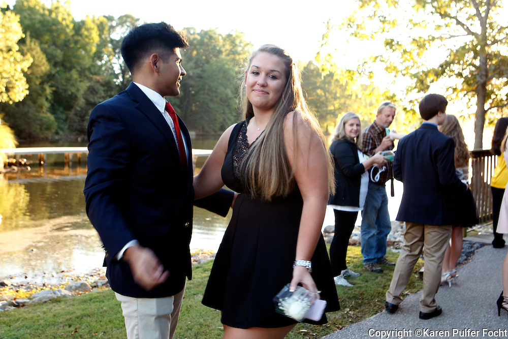 Teens mingling before going to the homecoming dance.
