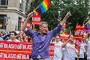 New York City Public Advocate Bill de Blasio, who is running for mayor of the city in 2013, waves a rainbow flag and waves to the crowd on Christopher Street.