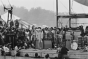 Jimi Hendrix playing part of the Star Spangled Banner on his electric guitar with his tongue after dawn at the Woodstock rock festival at Max Yasgur's 600 acre farm, in the rural town of Bethel, NY, on August 18, 1969.