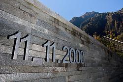 11.10.2010, Gedenkstätte, Kaprun, AUT, 10 Jahre Kaprun Katastrophe, Features, am 11.11. 2010 jährt sich die Brandkatastrophe von Kaprun das 10. Mal. Bei diesem Unglück mussten 155 Menschen ihr Leben lassen, im Bild das Datum der Tragödie vor der Gedenkstätte im Hintergrund der Schrägaufzug und die Tunneleinfahrt, wo sich das Unglück ereignete, EXPA Pictures © 2010, PhotoCredit: EXPA/ J. Feichter / SPORTIDA PHOTO AGENCY