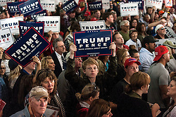 Oct.18, 2016 - Colorado Springs, Colorado, U.S. -  Donald Trump supporters show their signs to the media on the press riser after a Trump rally at the Norris Penrose Event Center.  Chants of ''Shame on you!'' and ''Tell the truth!'' were also directed at the reporters and photographers.(Credit Image: © Brian Cahn via ZUMA Wire)