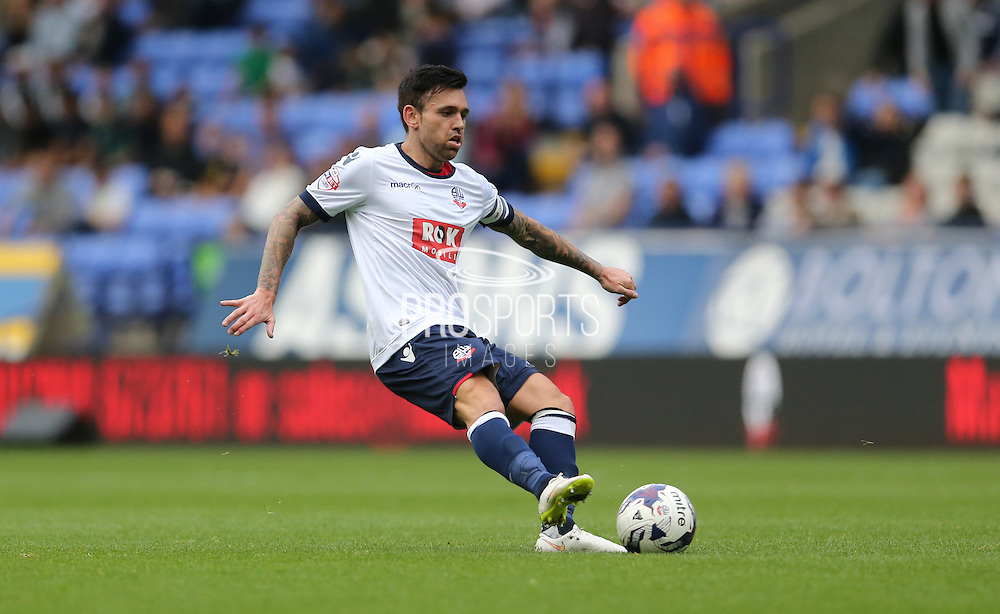 Bolton Wanderers midfielder Mark Davies shoots during the Sky Bet Championship match between Bolton Wanderers and Brighton and Hove Albion at the Macron Stadium, Bolton, England on 26 September 2015.