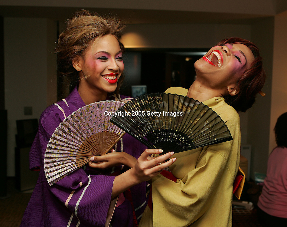 *** Exclusive Coverage*** TOKYO - APRIL 13: Singers Beyonce Knowles and Michelle Williams of Destiny's Child dressed in Japanese kimonos in Beyonce's hotel room before going to dinner at a traditional Japanese restaurant in Tokyo, April 13, 2005.  (Photo by Frank Micelotta/Getty Images).