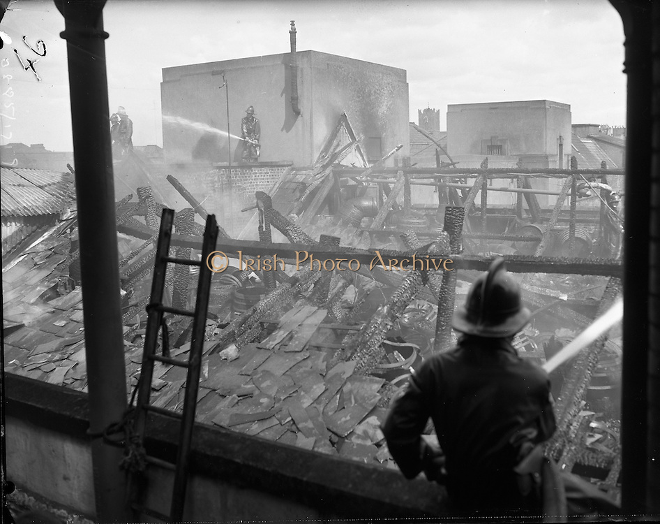 A fire at Powers Distillery, John's Lane, Dublin. The fire fortunately occurred during a period when the distillery was not in use, but a warehouse containing 4000 hogsheads of maturing whiskey was destroyed..05.07.1961