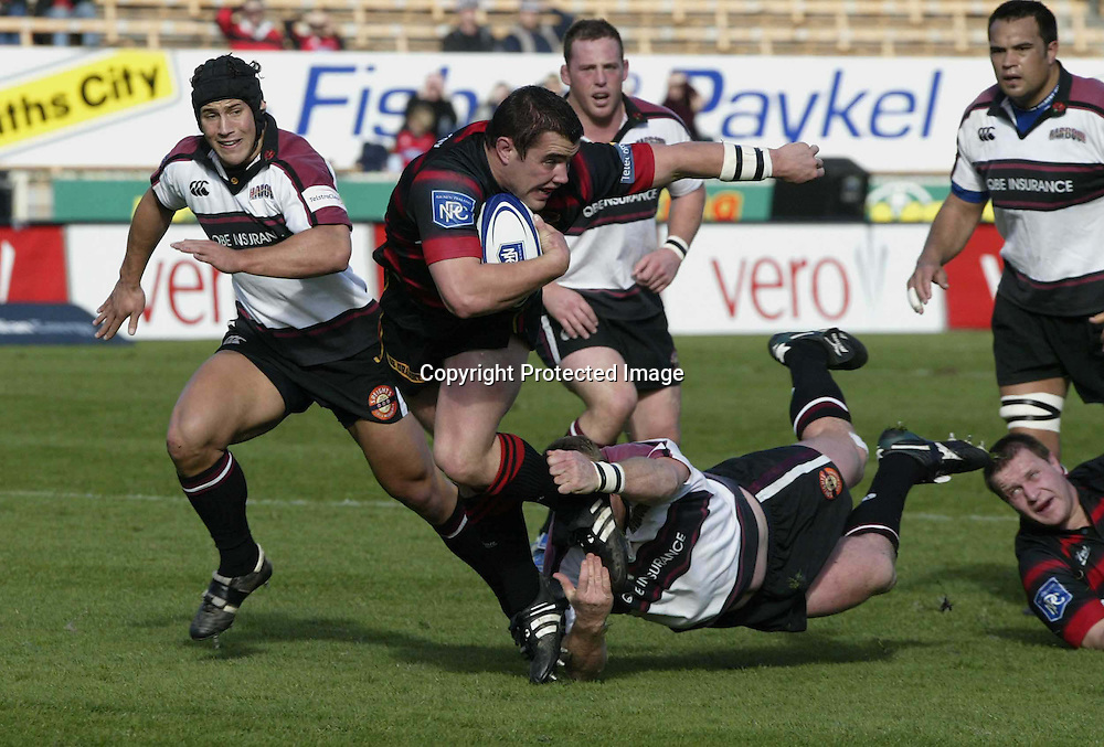 Canterbury's Corey Flynn on the attack during the NPC 1st division rugby match between Canterbury and North Harbour played at Jade Stadium, Christchurch, New Zealand August 21, 2004. The game ended in a 43 all draw.<br />Please credit:PHOTOSPORT