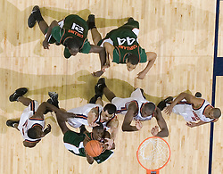 Miami Hurricanes guard/forward Brian Asbury (32) shoots against Virginia Cavaliers forward Jason Cain (33).  The University of Virginia Cavaliers defeated the Miami Hurricanes Men's Basketball Team 81-70 at the John Paul Jones Arena in Charlottesville, VA on February 3, 2007.