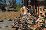 Amish-made rockers sit on the porch of the Log Cabin Gift Shop in French Camp, Mississippi. (Photo by Carmen K. Sisson/Cloudybright)