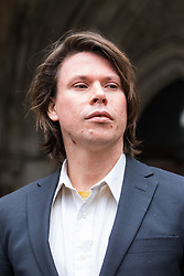 London - Alleged computer hacker Lauri Love arrives at the Royal Courts of Justice in London , pushing a mobile sound system playing electronic music, to find out whether he has successfully challenged a ruling that he can be extradited to the US, following allegations that he hacked United States government websites. PICTURED: Laurie Love and his girlfriend emerge from court to pose for the media. February 05 2018.