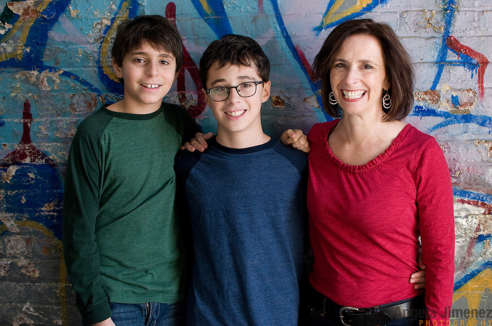 The Tasheff family sits for a family children teenager studio portrait sitting during the annual Holiday Portrait benefit at The Brooklyn Arts Exchange in Brooklyn, New York on December 4, 2011. ..Photograph by Angela Jimenez .Angela Jimenez Photography.www.angelajimenezphotography.com