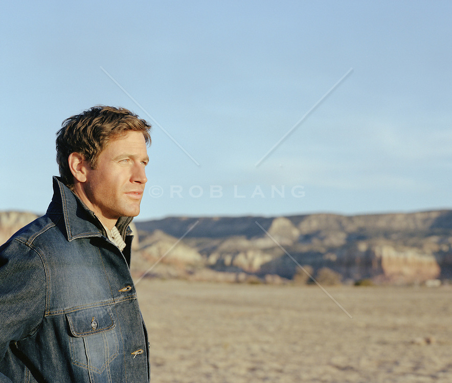portrait of a sexy All American man in a denim jacket outdoors