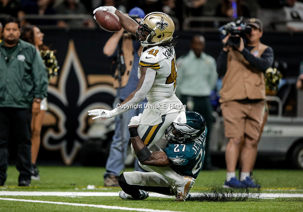 Nov 18, 2018; New Orleans, LA, USA; New Orleans Saints running back Alvin Kamara (41) scores past Philadelphia Eagles safety Malcolm Jenkins (27) during the second half at the Mercedes-Benz Superdome. Mandatory Credit: Derick E. Hingle-USA TODAY Sports