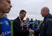 (R) Miroslaw Krogulec - Senior Manager Organizational Development and Sports Europe Eurasia Region Special Olympics  gives medals while medal's ceremony during Polish Soccer Tournament Unified of Special Olympics in Mietne on April 28, 2013.The idea of Special Olympics is that, with appropriate motivation and guidance, each person with intellectual disabilities can train, enjoy and benefit from participation in individual and team competitions...Poland, Mietne, April 28, 2013..Picture also available in RAW (NEF) or TIFF format on special request...For editorial use only. Any commercial or promotional use requires permission...Mandatory credit: Photo by © Adam Nurkiewicz / Mediasport
