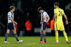 Craig Dawson and Claudio Yacob of West Brom look dejected after Tottenham Hotspur win 0-3 - Photo mandatory by-line: Rogan Thomson/JMP - 07966 386802 - 31/01/2015 - SPORT - FOOTBALL - West Bromwich, England - The Hawthorns - West Bromwich Albion v Tottenham Hotspur - Barclays Premier League.