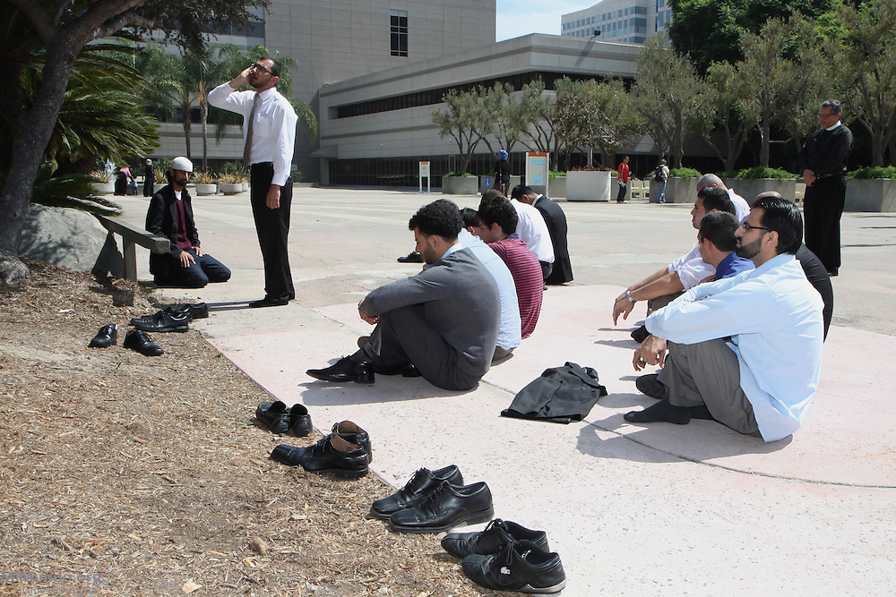 Defendants in the so-called Irvine 11 case pray before the sentencing. A jury found ten Muslim students from the University of California, Irvine, guilty of disrupting a February 2010 speech at the university's campus by Michael Oren, Israeli ambassador to the United States. Orange County Superior Court Judge Peter Wilson sentenced each student to three years of probation, 56 hours of community service, and ordered each to pay $270 in fines.