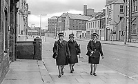 Three female traffic wardens and not a vehicle to be seen! Linenhall Street in central Belfast on the 13th day of the UWC, Ulster Workers' Council, strike. Normally Linenhall Street would have been bumper-to-bumper with vehicles and busy with pedestrians. 197405270296<br />