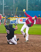 New Zealand's Wayne Laula slides into second as Canada's secondbaseman gets the out during playoff 2017 Men's World Softball Championship action on July 15.