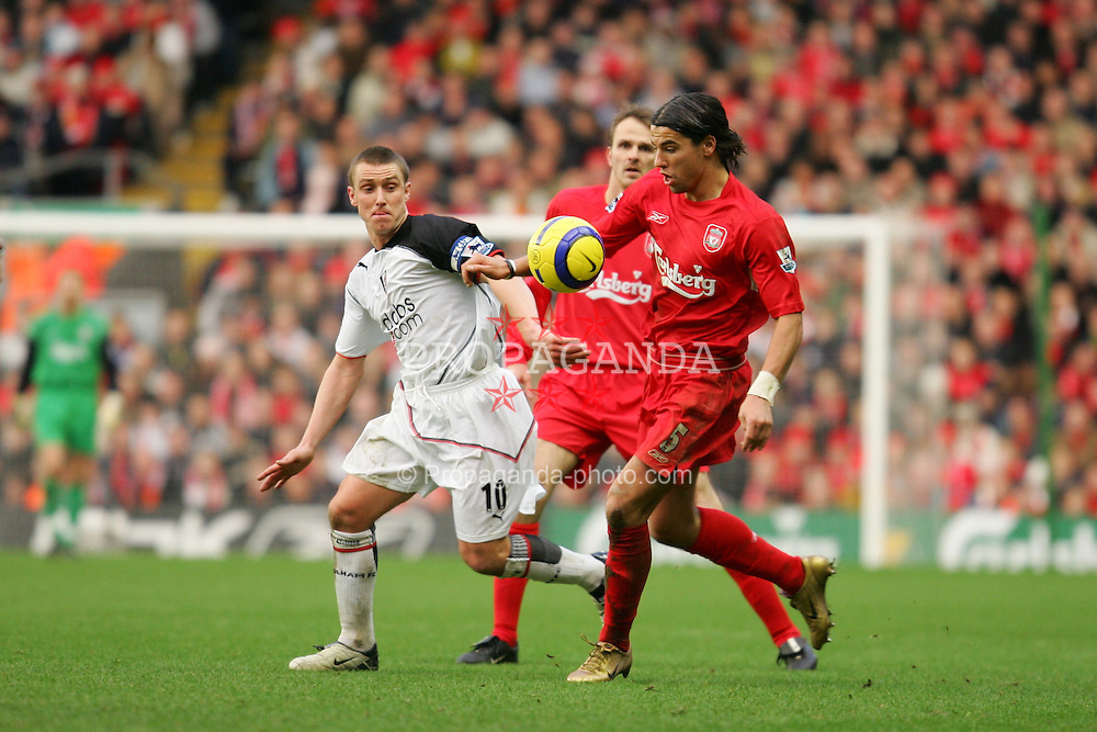 LIVERPOOL, ENGLAND - SATURDAY FEBRUARY 5th 2005: Liverpool's Milan Baros and Fulham's Lee Clark during the Premiership match at Anfield. (Pic by David Rawcliffe/Propaganda)