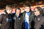 Jeff Stelling Men United March rounding off a 250-mile tour of 31 football clubs by walking from the Cherry Red Records Stadium on 30 March and he will stop off at Brentford, Fulham, Chelsea and QPR, before finishing off at Wembley Stadium on 30 March 2016. Jeff is pictured with his two sons. Photo by Stuart Butcher.
