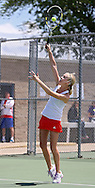 Cedar Rapids Washington's Lilly Hartman serves during the finals for the Doubles Draw of the Class 2A state tennis tournament at Veterans Memorial Tennis Center in Cedar Rapids on Friday, May 31, 2013.
